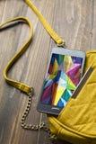 Женщины мобильного телефона и сумки Стоковое Изображение RF
