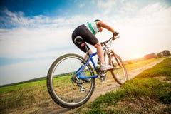 Женщины на велосипеде Стоковая Фотография