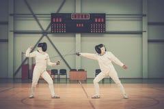 Женщины на ограждая тренировке Стоковые Фото