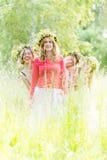 4 женщины нося венки Стоковые Изображения RF