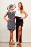 2 женщины нося модные платья Стоковые Фотографии RF