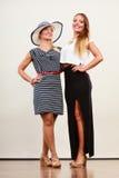 2 женщины нося модные платья Стоковое фото RF