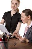 Женщины офиса смотря документы Стоковая Фотография