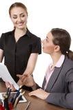 Женщины офиса смотря документы Стоковые Изображения