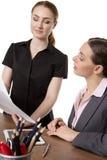 Женщины офиса смотря документы Стоковые Изображения RF