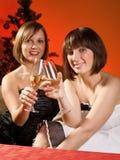 Женщины празднуя рождество Стоковые Изображения