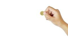 Женщины руки с изолятом сочинительства монетки на белой предпосылке Стоковые Фото
