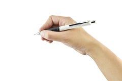 Женщины руки с изолятом сочинительства ручки на белой предпосылке Стоковые Фото