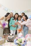 Женщины смотря камеру на детском душе Стоковое Изображение RF