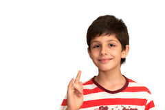 жесты мальчика делая нот франтовским стоковые фото
