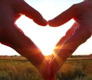 Жест с его руками в форме сердца Стоковые Изображения
