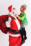 Желание 2016 рождества девушка маленький santa claus Говорить желания Стоковое Изображение RF