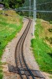 Железная дорога в солнечном дне, Швейцария Это классическая железная дорога Стоковые Изображения