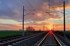 Железная дорога на заходе солнца Стоковое Фото