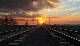 Железная дорога на заходе солнца Стоковая Фотография