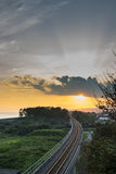 Железная дорога с заходом солнца Стоковые Фотографии RF