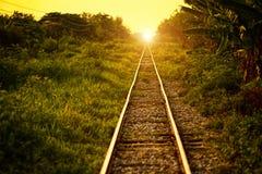 Железнодорожный путь & заход солнца Стоковые Фото