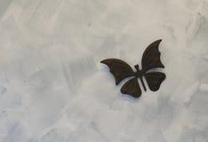 Железные butterflys на предпосылке цемента Стоковое Изображение