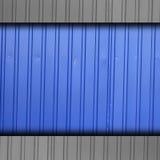 Железный grunge стены предпосылки голубой нашивки загородки Стоковая Фотография