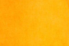 Желтая абстрактная текстура покрашенная на предпосылке холста искусства Стоковое Изображение