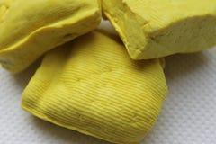 Желтая бирманская предпосылка текстуры тофу Стоковая Фотография