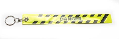 Желтая лента бирки вида предупредительного знака опасности Стоковое фото RF