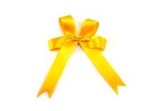 Желтая лента при смычок изолированный на белой предпосылке Стоковое фото RF