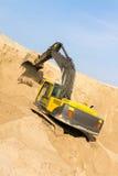 Желтая землечерпалка на работе Стоковое Изображение