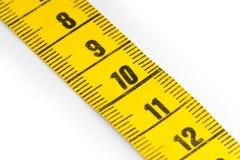 Желтая измеряя лента - селективный фокус Стоковые Изображения