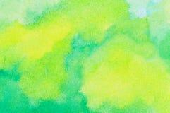 Желтая и зеленая покрашенная предпосылка мытья чернил Стоковое Изображение RF