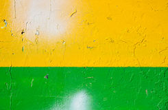 Желтая и зеленая текстурированная предпосылка краски Стоковое фото RF
