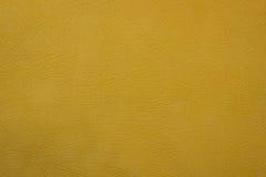 Желтая кожаная искусственная предпосылка текстуры Стоковое Изображение