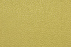 Желтая кожаная grained картина предпосылки текстуры Стоковая Фотография
