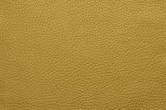 Желтая кожаная grained картина предпосылки текстуры Стоковые Изображения