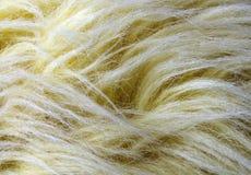 Желтая предпосылка искусственного меха Стоковые Изображения