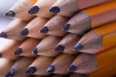 Желтая предпосылка карандаша Стоковые Изображения RF