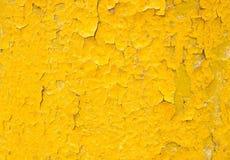 Желтая предпосылка с старой краской Стоковые Изображения