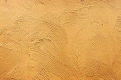 Желтая предпосылка текстуры бетонной стены краски Стоковое Изображение