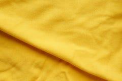 Желтая предпосылка текстуры хлопко-бумажной ткани Стоковая Фотография