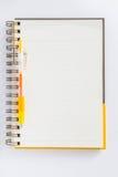 Желтая ручка на тетради Стоковая Фотография