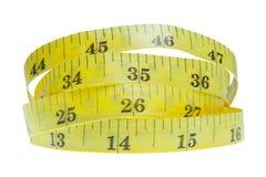 Желтая спиральная рулетка на белой предпосылке с острословием Стоковое Изображение