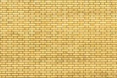 Желтая стена сделанная кирпича для предпосылки и текстуры Стоковая Фотография