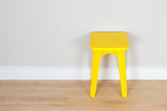 Желтая табуретка Стоковые Фото