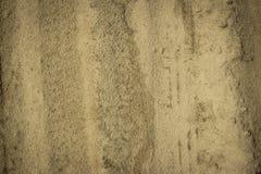 Желтая текстура песка может использовать для предпосылки Стоковые Изображения
