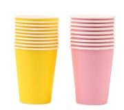 2 желтое и розовые стога бумажных стаканчиков. Стоковое фото RF