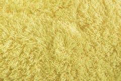 Желтое мех текстуры ткани Стоковая Фотография
