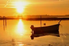 Желтое море на заходе солнца Стоковые Изображения