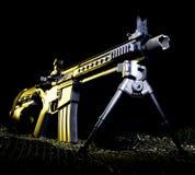 Желтое оружие стоковые изображения