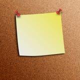 Желтое примечание ручки с штырями нажима Стоковая Фотография RF
