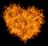 Желтое сердце пожара на черноте Стоковое фото RF